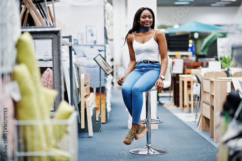 Portrait of a beautiful african american woman sitting in the store.