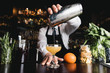 canvas print picture - Bartender pouring cocktail