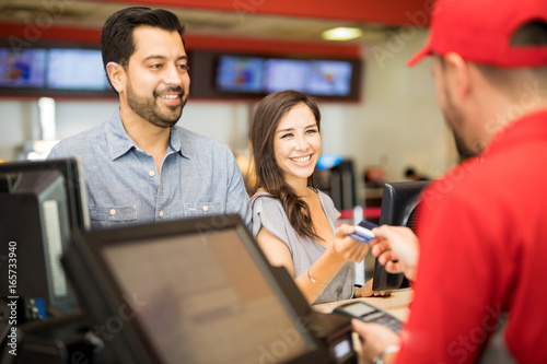 Fototapety, obrazy: Woman paying for tickets on a date