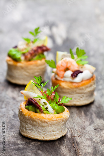 Photo Vol-au-vents  puff pastry cases filled with salted squid and octopus