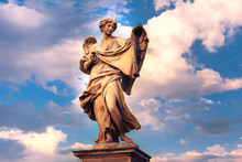 Marble Statue Of Angel With The Sudarium At Sunset, One Of The Ten Angels On Saint Angel Bridge, Symbols Of Christ's Passion, Rome, Italy