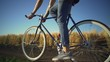 Strong young man riding bicycle near wheat field sundown slow motion rapid