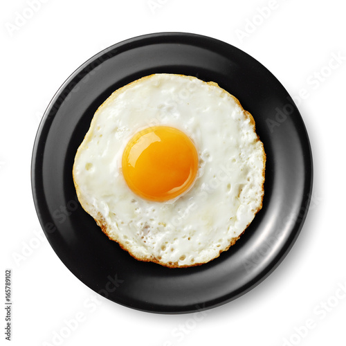 Foto op Plexiglas Gebakken Eieren fried egg on black plate