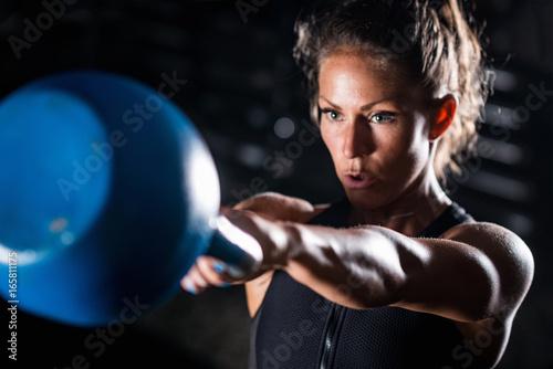 Fotografie, Obraz  Woman athlete exercising with kettlebell