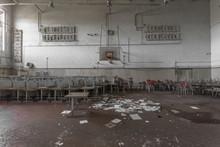 Gymnasium With Stacked Desks I...