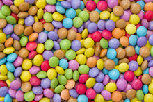Many Colorful Round Candies Texture Background