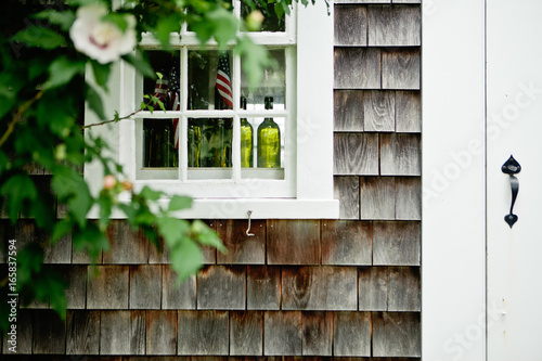 the exterior of a shingled house on the island of martha's vineyard
