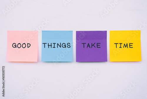 Photo  Good things take time - Inspirational and motivation quotes on colorful sticky paper on a wall, pastel colors