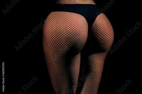 Fényképezés Ass and hips wearing black fishnet pantyhose tights and panties