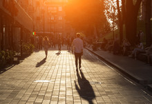 People In The Evening Are Walking Along The Street A Man Is Going To Meet A Woman