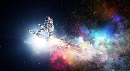 Spaceman on flying board. M...