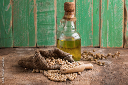 Tuinposter Boeddha closeup is some soybeans with wooden spoon