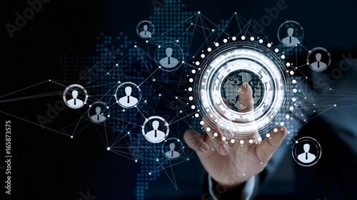 Fototapeta Businessman touching virtual screen a global customer network connection obraz na płótnie