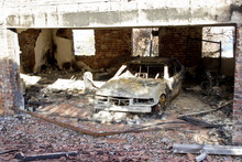 Motor Car Destroyed By Fire