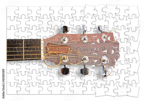 Fotografie, Obraz  Step by step to learn to play the guitar - concept image in puzzle shape