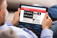 Man Reading Unfolds Scandal News On Digital Tablet