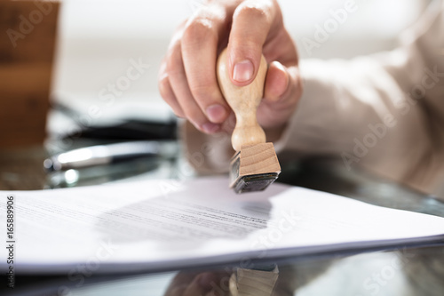 Photo Close-up Of A Person Stamping On Document