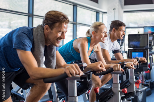 Photo sur Toile Fitness People on exercise bike