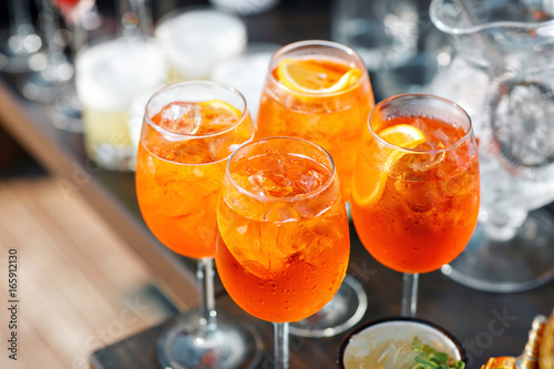 Photo Aperol spritz cocktail in misted glass, selective focus