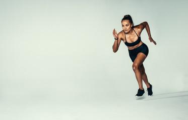 Hispanic female runner working out in studio