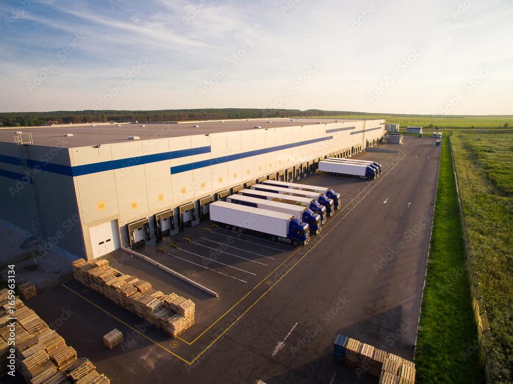 Fototapeta distribution warehouse with trucks of different capacity