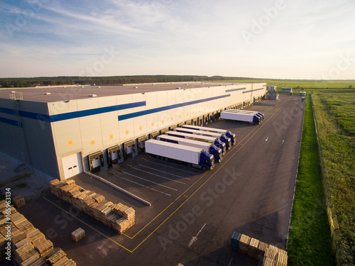 distribution warehouse with trucks of different capacity Wallpaper Mural