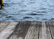 textured background - old wooden dock over blue water
