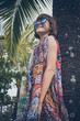 Tropical woman vacation concept. Young woman and palm. Bali island, Indonesia.