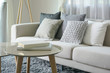 Leinwandbild Motiv Earth tone style sofa and pillows with round center table in the living room