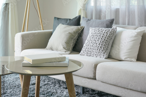 Stampa su Tela Earth tone style sofa and pillows with round center table in the living room