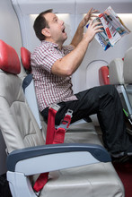 Shocked Unfastened Man On The Plane During Turbulence Levitates. Accident Passenger Who Is Not Fasten To The Seat.