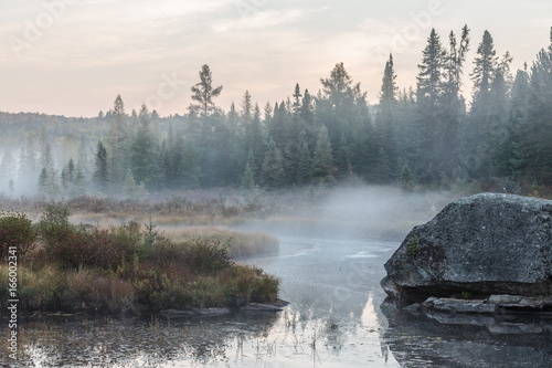 Misty morning over the lake in Algonquin Park in autumn Wallpaper Mural