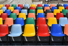 Colorful Plastic Chairs  In Rows  Horizontal Shoot