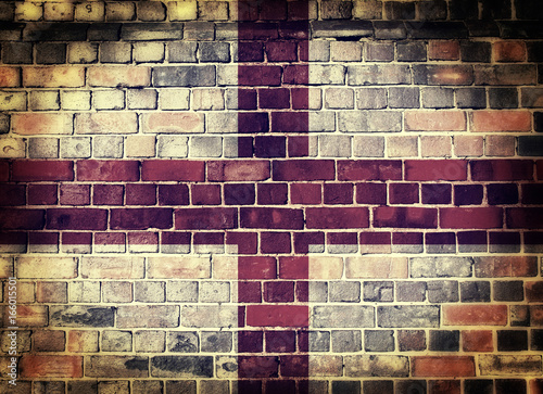 Vászonkép Grunge England flag on a brick wall