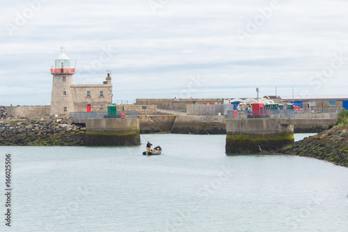Photo  Howth harbor in Ireland, lighthouse and boat