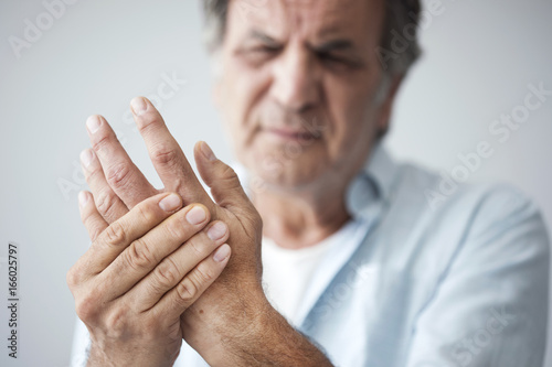 Old man with finger pain Wallpaper Mural