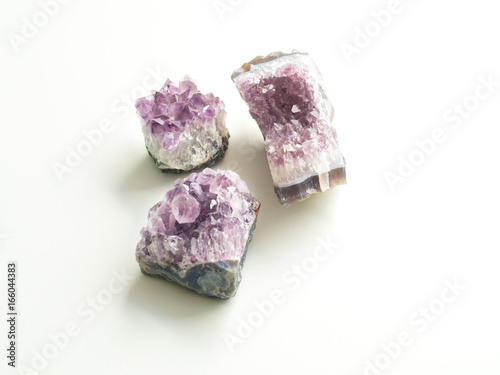 Tuinposter Three Amethyst geodes for crystal therapy treatments and reiki
