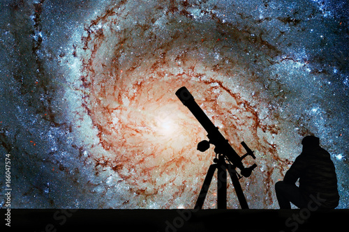 Man with telescope looking at the stars Canvas Print