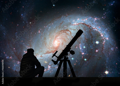 Fotografie, Obraz  Man with telescope looking at the stars