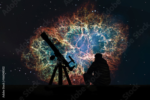 Man with telescope looking at the stars. Crab Nebula in constellation Taurus. Supernova Core pulsar neutron star.