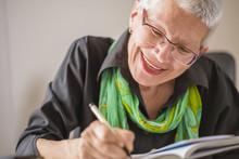 Senior Old Woman Writing Down ...