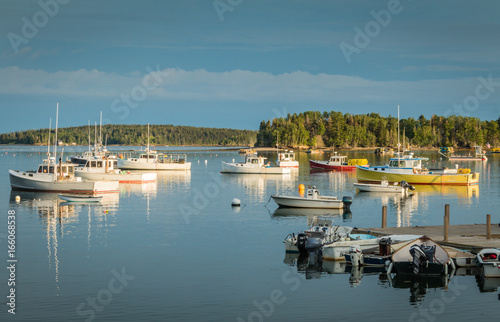 Fotografia, Obraz  Lobster boats are moored in the harbor at dusk in Friendship, Maine