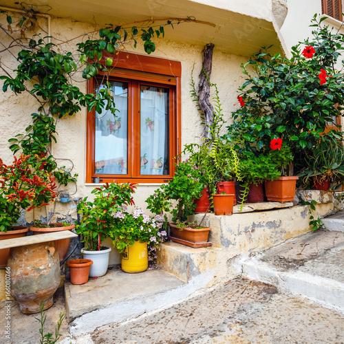 Foto op Plexiglas Landschappen Narrow street in the village of Kritsa near Agios Nikolaos, Crete, Greece