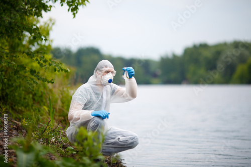 Valokuva  Laboratory assistant with bulb, summer