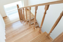 Wooden Staircase In A White Mo...