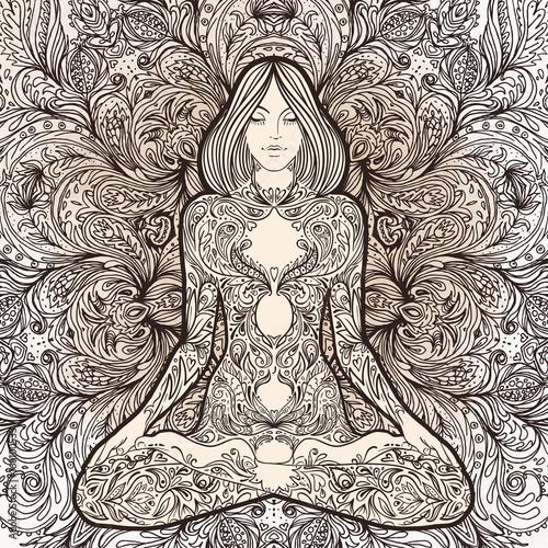 Photo  Pretty girl in yoga pose over ornate round mandala pattern