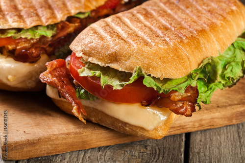 Staande foto Snack Toasted ciabatta sandwich with smoked bacon, cheese and tomato