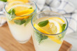 Glasses of fresh lemonade on table, close up
