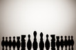 Silhouette of chess pieces on a white background