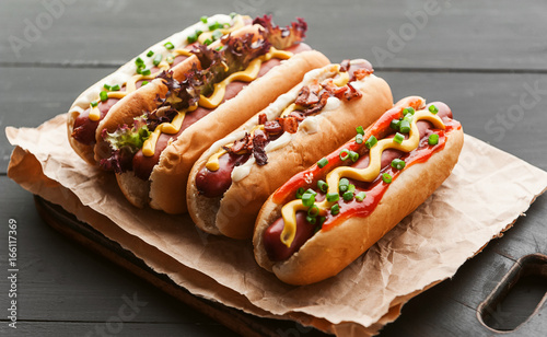 Fotografie, Obraz  Barbecue Grilled Hot Dogs with  yellow American mustard, On a dark wooden backgr